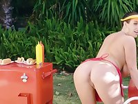 Busty owner of hot dog cart seductively demonstrates her products