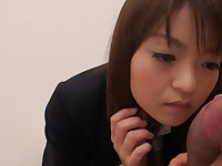 Cute Japanese clerk polishes boss' phallus in his cabinet