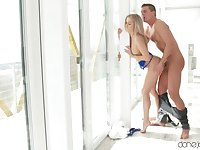 Hot blonde babe fucks by the window