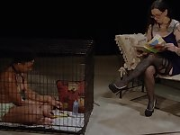 Ebony lesbian slave masturbates in a cage by her mistresses orders