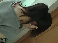 Dark haired asian chick pissing on hidden cam
