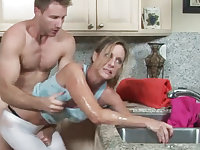 MILF gets her hand stuck in the drain, her son helps