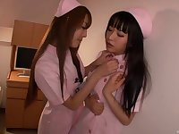 Cute Japanese teen lesbian nurses finger each other