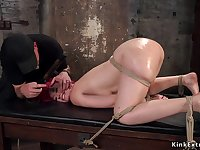 Full-Bosomed redhead with big bootie takes hogtie