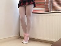 Schoolgirl white hose removing mini skirt