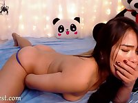 Amateur brunette asian teen camgirl in front of the webcam
