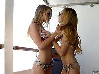 Slender babe Kali Renee is dildo fucking beautiful lesbian girlfriend on the balcony