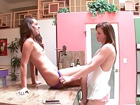 Lesbian teen couple Delilah Davis and Sami St. Clair in the kitchen