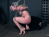 Blonde in a miniskirt and stockings Cara Day tied up and pussy abused