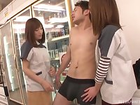Two Japanese brunette teen babes fuck a lucky guy in a public place