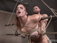 Teen bombshell Scarlet De Sade strapped in and abused with cock