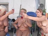 Mature short haired MILF babes get facials in an outdoor orgy