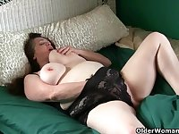 Large-Breasted granny takes care of her throbbing clit