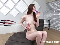 Leggy solo girl with milky white skin plays with her pussy