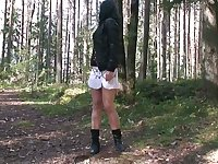 All natural raven haired bitch squats down and pisses a bit in the forest