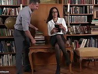 Gorgeous brunette librarian with glasses, Ginebra Bellucci is sucking cocks instead of reading books