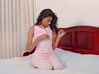 Tanned Venezuelan babe Scarlett Camila is finger fucking wet pussy