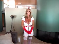 Blonde nurse with massive milk jugs is sucking her patient's dick, while kneeling in front of him