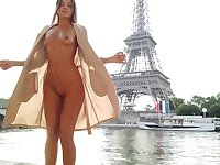 Tall exhibitionistic babe flashing her ass and tits next to Eiffel Tower