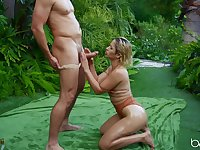 Captivating Goldie Rush oiled and fucked in lush foliage